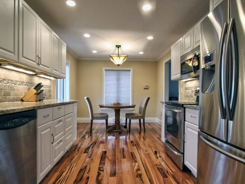 Kitchen-Remodel-Wood-Floor-White-Cabinets