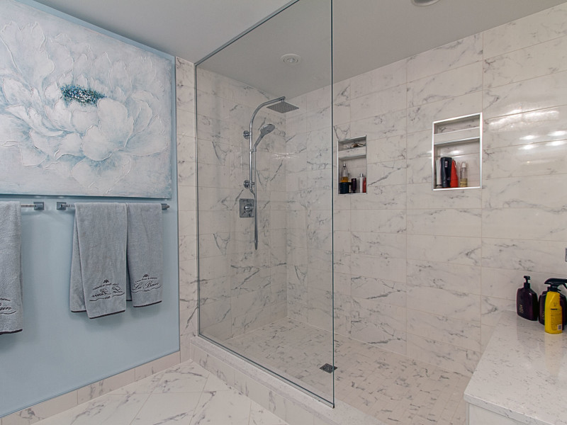 white tile-marble look tile-shower niche-shower glass