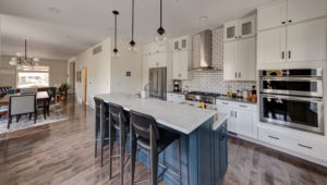 kitchen remodel-white cabinets-blue cabinets-kitchen island-wood floors-pendant lights-backsplash tile-subway tile